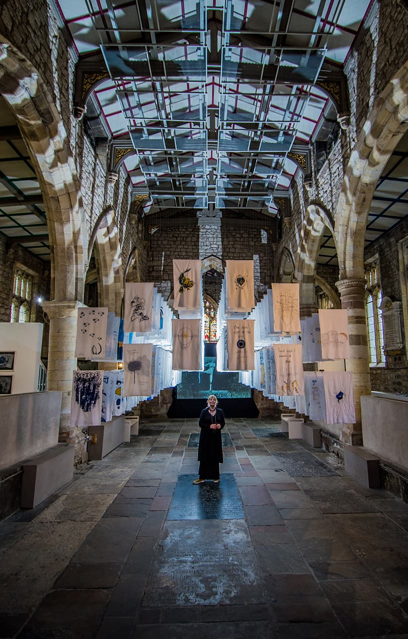 <strong>1001 Nights</strong>, installation of embroidered pillowcases, Susan Aldworth. Shown in <i>The Dark Self</i>, York St Mary's, 2017. Photograph by James Hardisty,