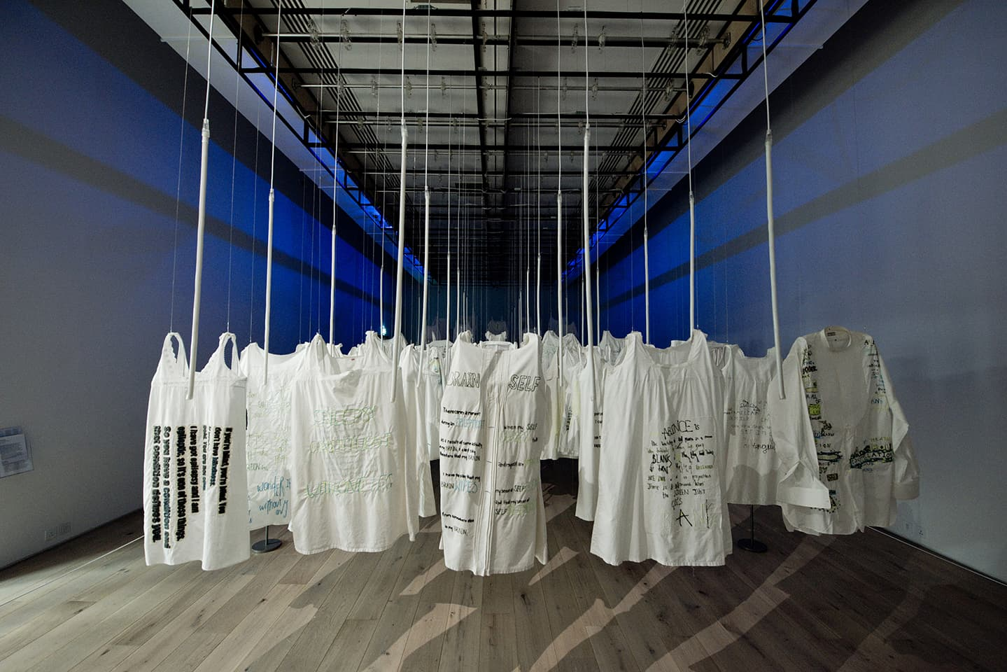 <strong>Out of the Blue</strong>, installation of 106 items of embroidered underwear, Susan Aldworth, 2020. Photograph by Colin Davison at Hatton Gallery.