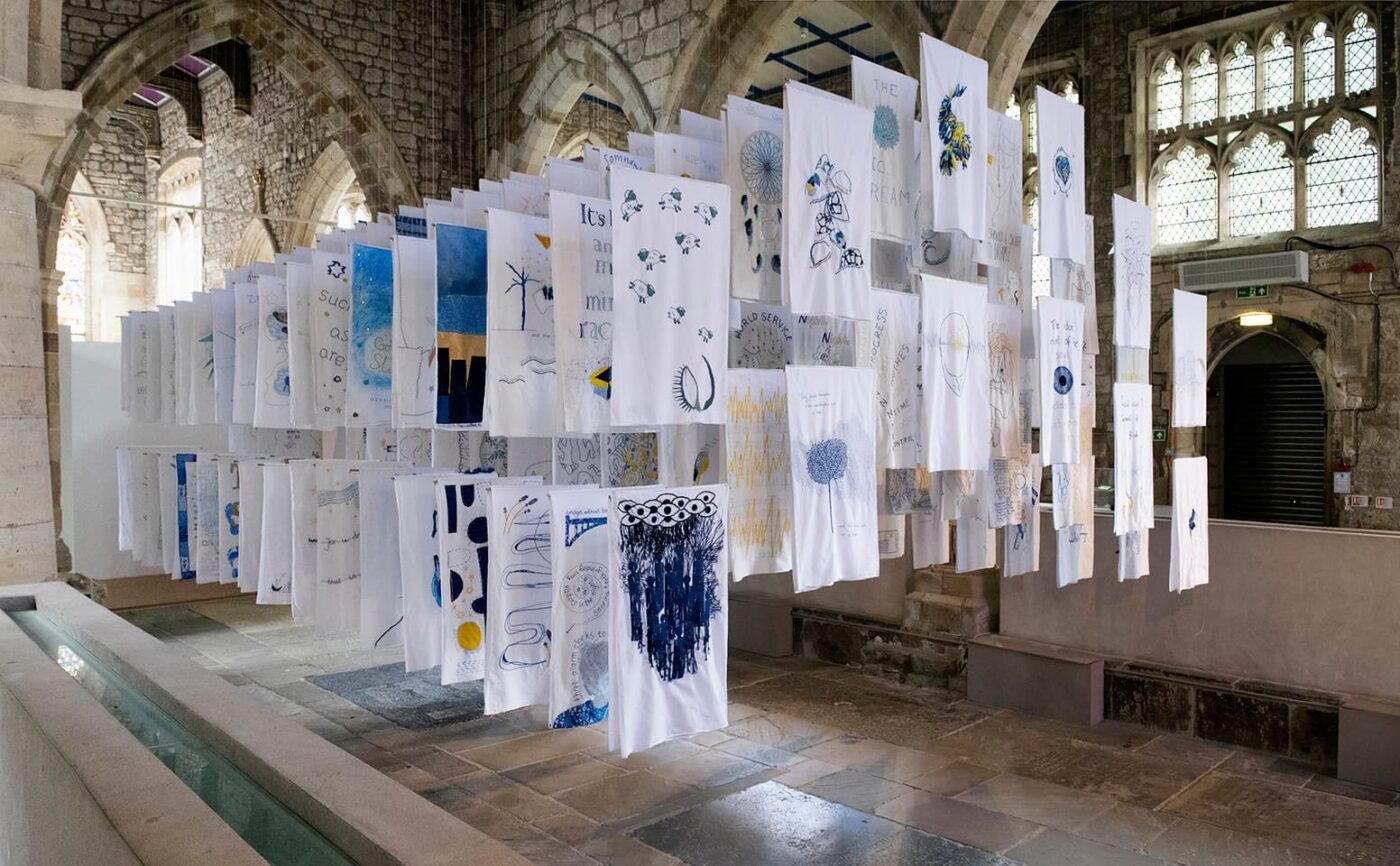 <strong>1001 Nights</strong>, installation of embroidered pillowcases, Susan Aldworth, 2017. Photograph by Paul Hughes.