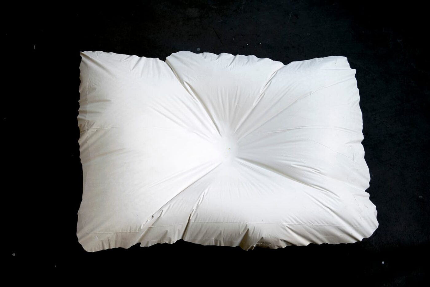 <strong>Evidence of Sleep III</strong>, (detail) installtion of 5 plaster pillows, Susan Aldworth, 2017. Photograph by Paul Hughes.