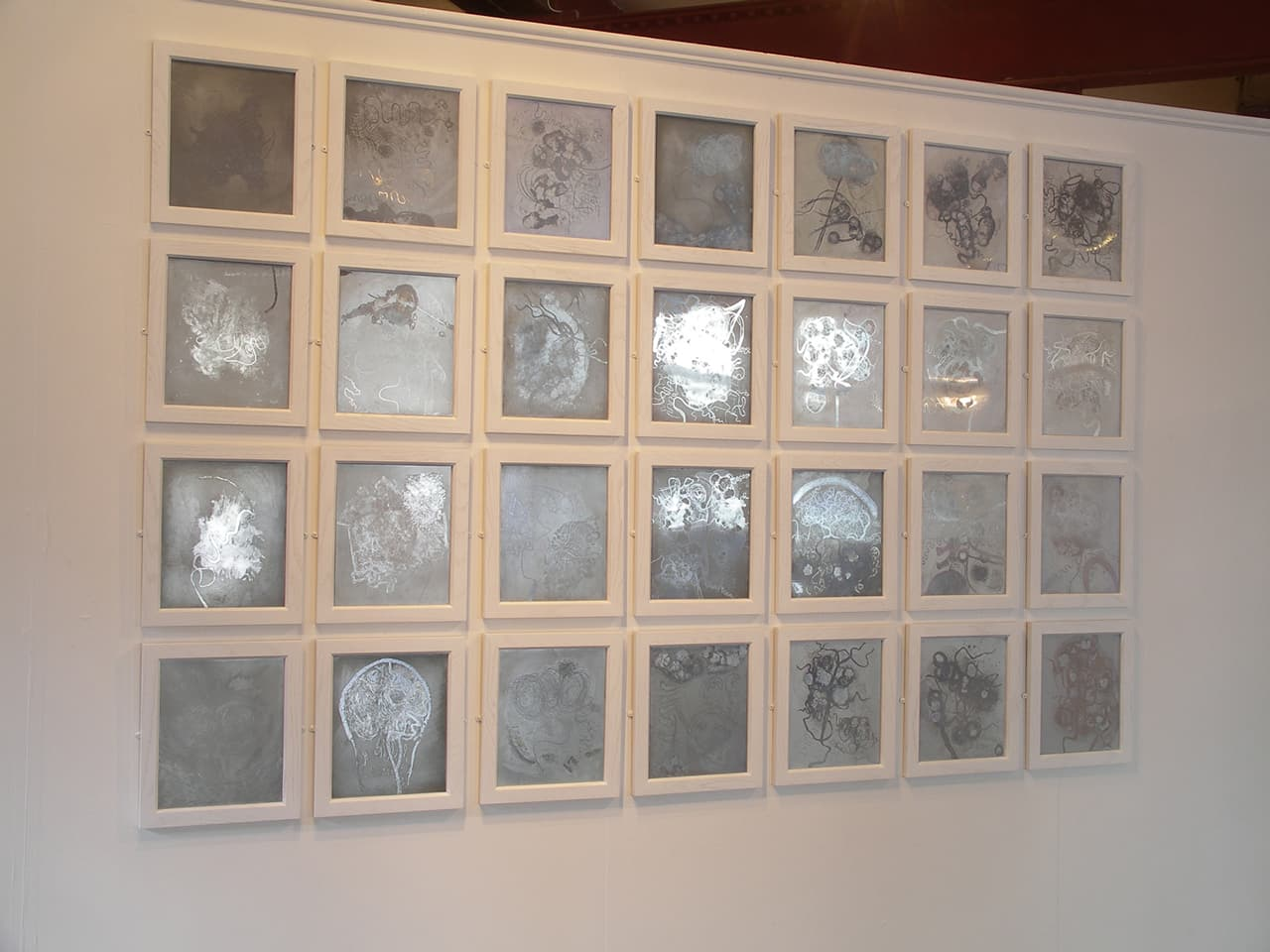 Mirror <strong>Brainscapes</strong>. Installation of 28 zinc etching plates, Susan Aldworth, 2002. Photograph at Whitechapel Gallery, London by Brian Campbell.