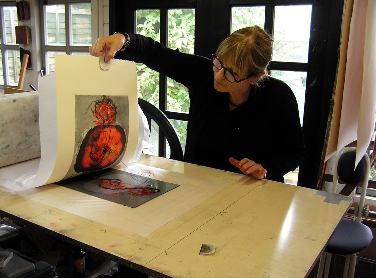 Susan Aldworth working in Oxley's Bexhill studio on The Deep Sleep monoprints, 2016.